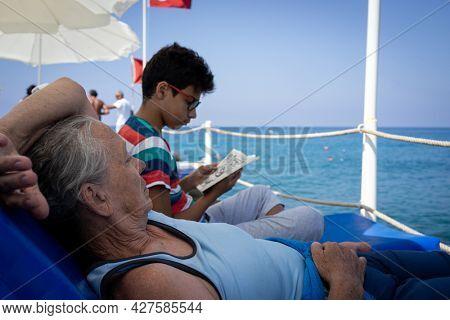 Senior woman on pier with grandsonSenior woman on pier with grandson joy. High quality photo