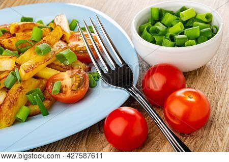 Fork On Blue Plate With Fried Potato, Green Onion And Tomatoes Cherry, Bowl With Chopped Scallion, T