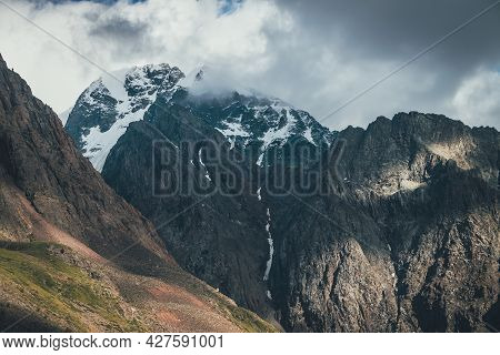 Scenic Alpine Landscape With Great Rocks And Big Snowy Mountains In Low Clouds. Wonderful View To Mo