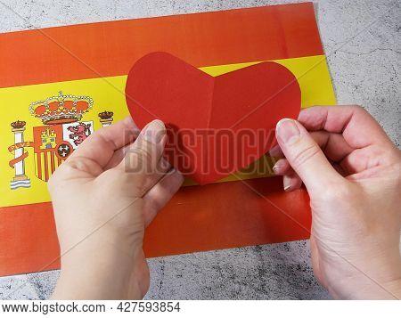 I Love Spain. Hands Make Heart On Spanish Flag Background. 12 October National Day Of Spain, Hispani