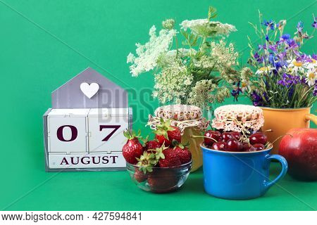 Calendar For August 7 : The Name Of The Month Of August In English, Cubes With The Numbers 0 And 7,