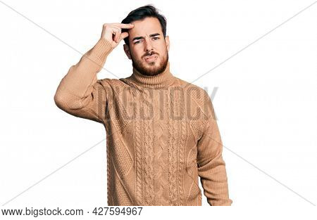 Young hispanic man wearing casual clothes worried and stressed about a problem with hand on forehead, nervous and anxious for crisis