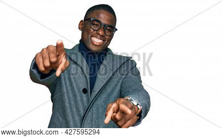 Young african american man wearing business clothes and glasses pointing to you and the camera with fingers, smiling positive and cheerful