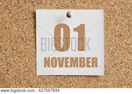 November 01. 01th Day Of The Month, Calendar Date.white Calendar Sheet Attached To Brown Cork Board.