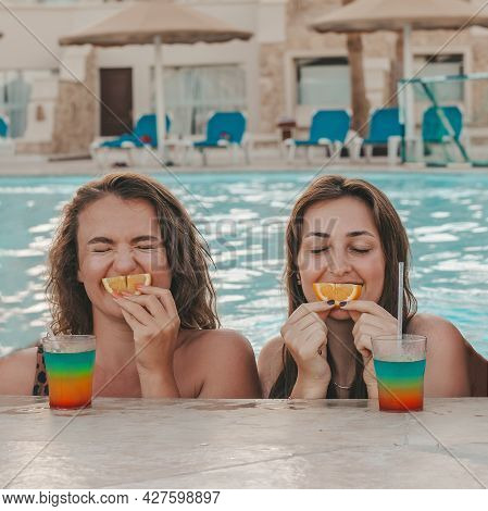 Group Of Beautiful Young Women Have A Rest On A Pool. Friends Rest On The Pool
