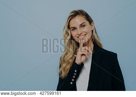 Smiling Blonde Girl In Black Coat Keeping Good News As Secret, Decides Its Better To Wait Before Tel
