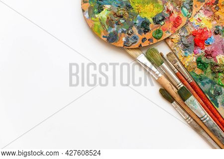 Colorful Palette Wooden, Brushes And Paint Background. Artistic Oil Painting. Artist's Workshop