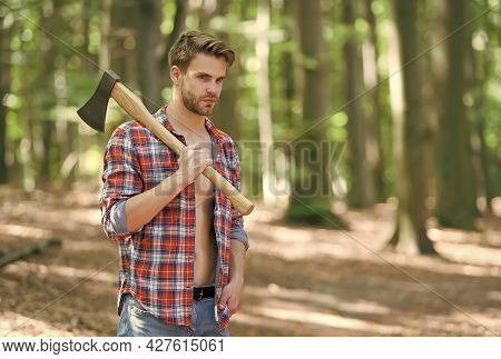 Managing Forest. Handsome Guy Carry Chopping Axe In Wood. Tree Chopping. Forestry Logging. Lumberjac