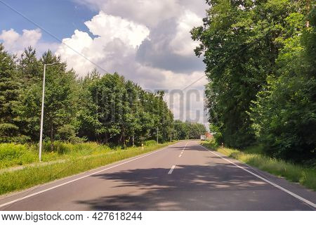 Road In The Countryside. Summer Travel. Rural Street. Forest