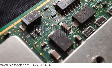 Close-up Of Electronic Circuit Board . Green Printed Circuit Board, Background Technology.