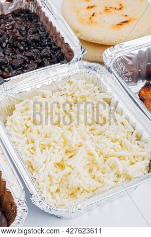 Container Full Of Fresh White Cheese Ideal For Filling The Arepas