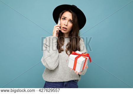 Shot Of Pretty Dissatisfied Young Brunette Female Person Isolated Over Blue Background Wall Wearing