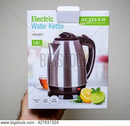 Paris, France - April 24, 2021: Pov Male Hand Holding Front Part Of Package Activer Electric Water K