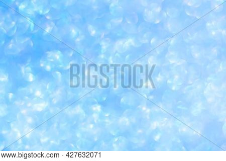 Defocused Blue Background . Abstract Blurred Bokeh Light.