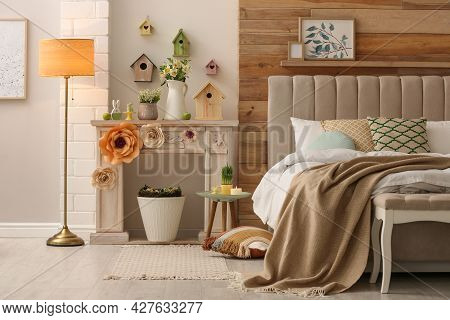 Decorative Fireplace With Modern Furniture In Bedroom. Interior Design