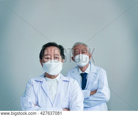 Front line Asian senior medical service doctors anxiety worry and depress with pandemic situation fe