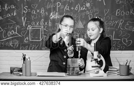 Science Experiments In Laboratory. Little Girls Scientist With Microscope. Chemistry Research In Lab