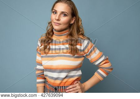 Young Charming Fascinating Self-confident Positive Blonde Woman Wearing Casual Striped Pullover Isol