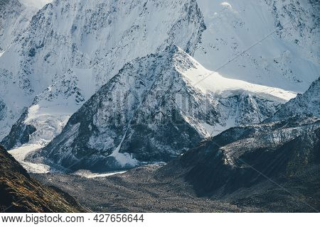 Awesome Mountain Landscape With Big Snow Rock With Peaked Top On Background Of Giant Snow-covered Mo