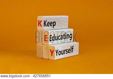 Key, Keep Educating Yourself Symbol. Wooden Blocks With Words 'key, Keep Educating Yourself'. Beauti