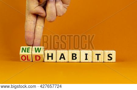 New Or Old Habits Symbol. Businessman Turns Wooden Cubes And Changes Words 'old Habits' To 'new Habi
