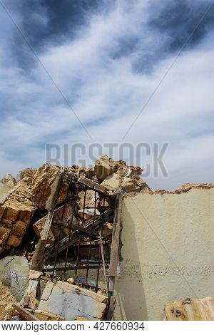 Remains Of A Ruined House With The Blue Sky In The Background