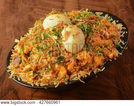 Traditional Mughal Chicken Biryani Made Of Basmati Rice Cooked With Masala Spices And Boiled Eggs, S