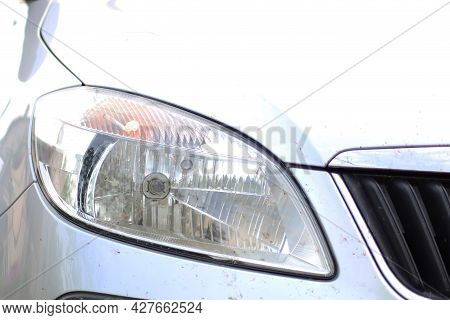 Front Of The Car With Headlights Close-up. Front Bumper And Headlight Close-up.