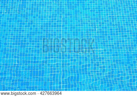 Blue Tiles On The Bottom Of The Pool. Ripples Distorting The Blue Tile Lining Of A Pool. Top View Sw