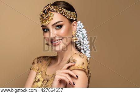 Portrait Of Beautiful Indian Girl. Young Hindu Woman Model With Golden Kundan Jewelry Set, Earrings,