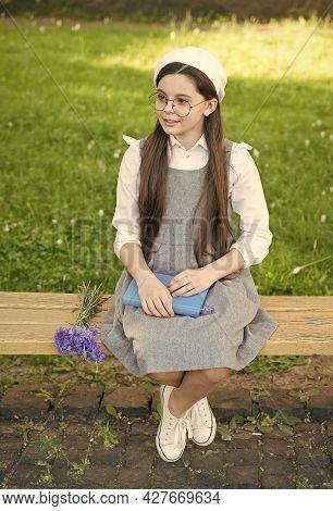 Define Your Style. Small Child Sit On Bench Outdoors. Little Girl Wear School Dress. School Uniform