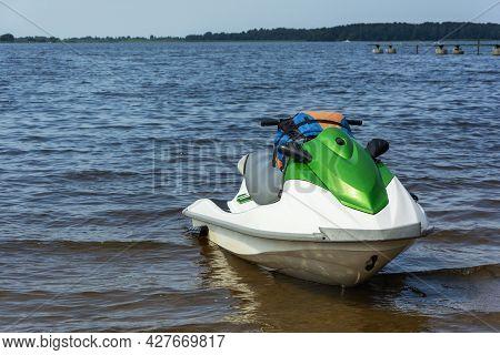 Beautiful Green Jet Ski On The Lake, Jet Skiing, Active Lifestyle, Summer, Water, Heat, Vacation.