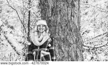 Woman Smiling Near Tree. Holiday Winter Day. Pretty Woman In Warm Clothing. Enjoying Nature Winterti