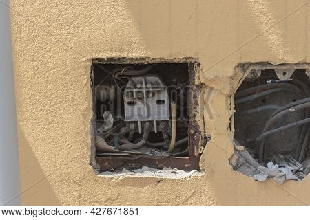 Street, Old Faulty Electrical Outlet On The Wall On The Front Side Of The Building