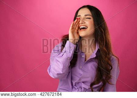 Crying Emotional Young Woman Screaming On Blue Studio Background