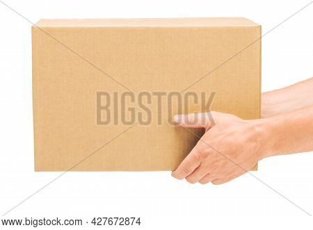 Corrugated Cardboard Box In Male Hands On An Isolated White Background, No People, Part Of The Body