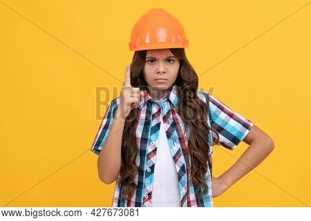 Strict Teen Girl With Curly Hair In Construction Helmet, Expert