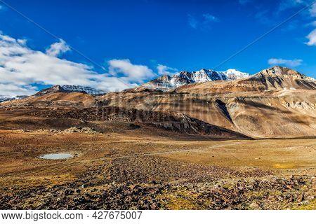 Himalayan landscape in Himalayas along Manali-Leh with small lake road view from Baralacha La Pass. Himachal Pradesh, India