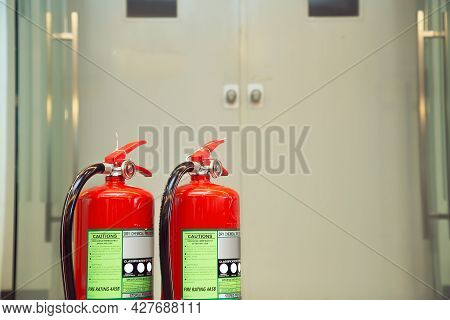 Fire Extinguisher, Close-up Red Fire Extinguishers Tank With Door Exit In The Building Concepts Of P