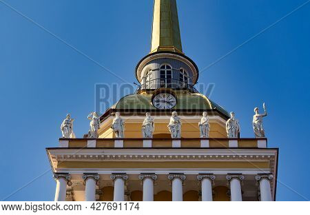 Fragment Of The Admiralty Tower In St. Petersburg Against The Blue Sky. Historical Sights Of St. Pet