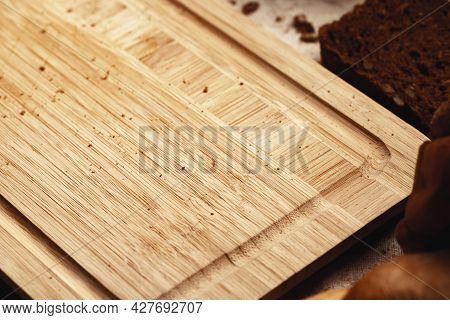 Wooden Board With Bread Crumbs Close Up