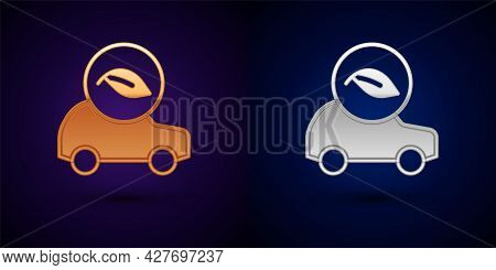 Gold And Silver Eco Car Concept Drive With Leaf Icon Isolated On Black Background. Green Energy Car
