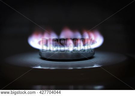 Burning Blue Gas On The Stove. The Flame Of A Burning Gas Fire On A Black Background.