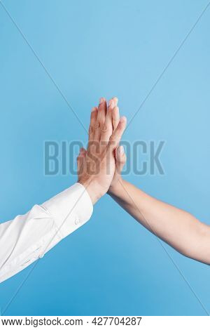 Father Daughter Doing High Five. High Quality Beautiful Photo Concept