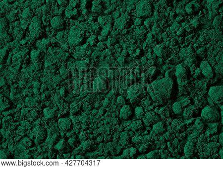 Green Powder Background. Spirulina Powder Closeup. Detox Superfood.