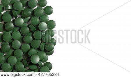 Spirulina Green Pills Border Isolated On A White Background. Chlorella Pills. Superfood, Organic Foo