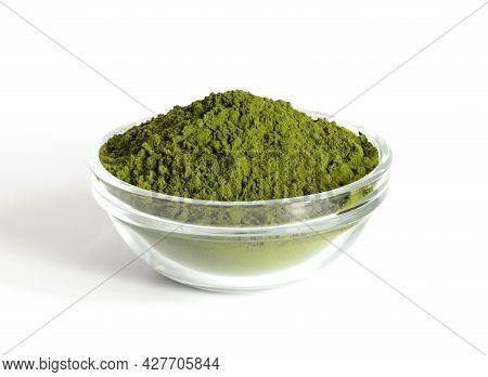Chlorella Powder In A Bowl Isolated On A White Background. Green Spirulina Algae Powder Or Barley. D