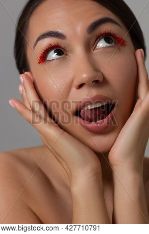 Beautiful Spa Girl With Perfect Clean Skin. Woman Looks At The Camera In Surprise Opening Her Mouth.