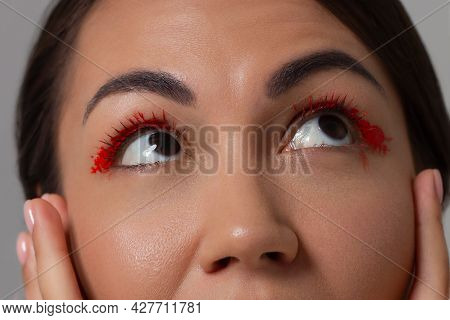 Close-up Of Surprised Eyes With Red Eyeliner. Brown Eyes, Perfect Eyebrows And Long Eyelashes. Visio