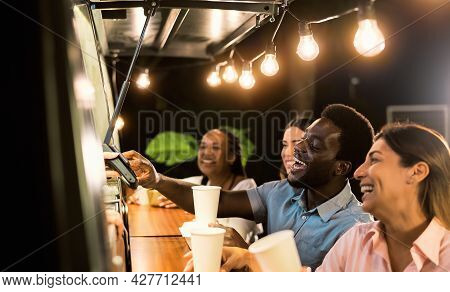 Happy Multiracial People Buying Meal From Food Truck Kitchen - Modern Business And Take Away Concept